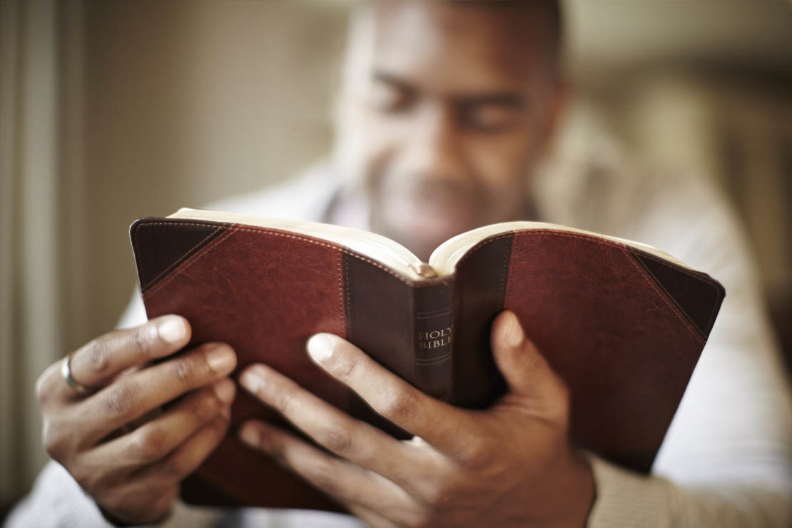 man reading a bible